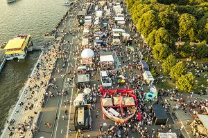 top aerial view of many people walki