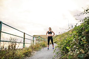 Young sporty woman runner in black