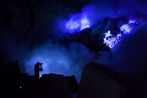 Photograper in a blue light of fire