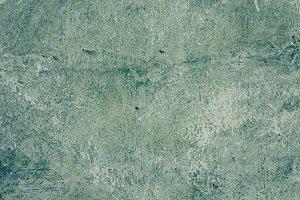 Worn green wall background texture.