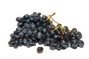 Black grapes isolated on white.