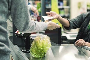 abstract consumer in food store cash