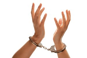 Handcuffed Woman Raises Hands in Air