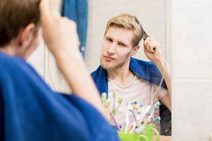 male adult comb hair in bathroom loo