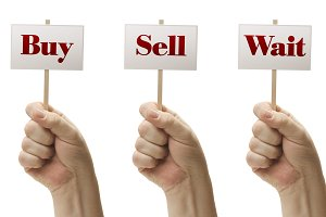 Three Signs Saying Buy, Sell, Wait