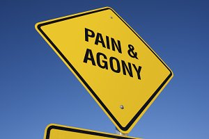 Pain and Agony Yellow Road Sign