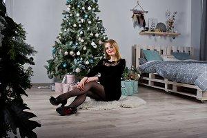 Cute blonde girl on black dress agai