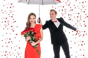 couple with umbrella and roses