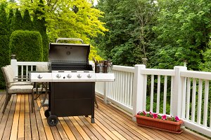 Open BBQ cooker with cold beer