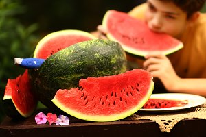 teenager boy with cut water melon