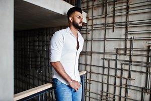 Stylish tall arabian man model in wh