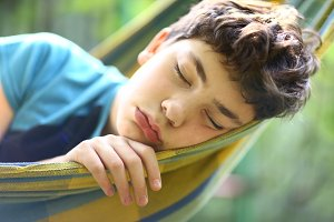 teenager boy resting in hammock