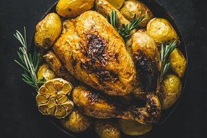 Roasted chicken with vegetables in p