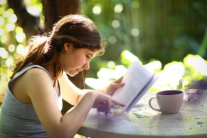 teenager student girl reading book