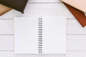 Open blank notepad with empty white