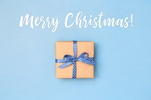 Merry Christmas card with gift box.