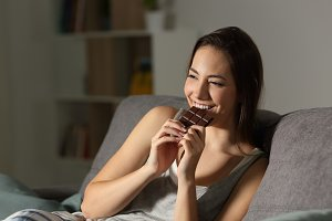 Woman enjoying eating chocolate