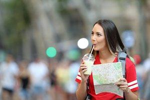 Teen tourist sightseeing drinking