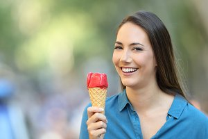 Happy woman holding an ice cream