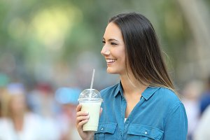 Happy woman holding a smoothie