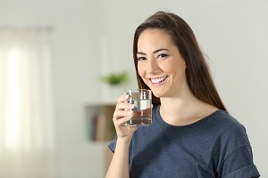 Happy girl holding a drinking glass
