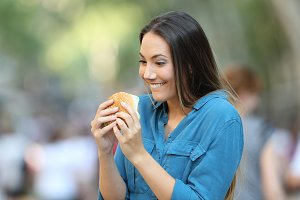 Excited woman ready to eat a burger