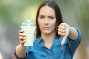Angry woman holding a smoothie