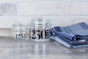 Two glass jars and kitchen towels