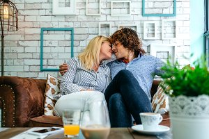 Couple kissing on a sofa