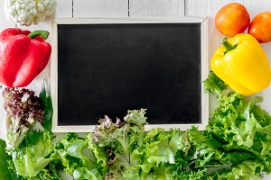 Healthy vegetables and black board