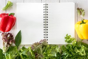Healthy vegetables and note book on