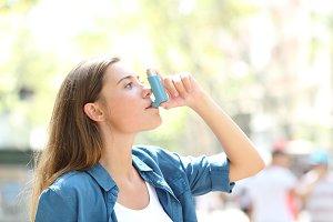 Asthmatic woman using a inhaler