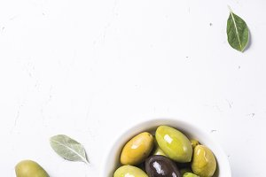 Black and green Olives  on whit