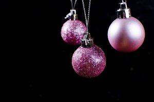 Purple christmas balls on green spru