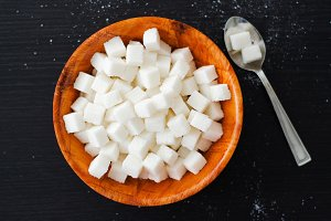 Sugar cubes in a wooden bowl