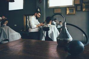 Male hairdresser works at the barber