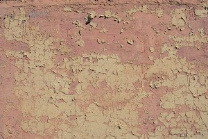Worn pink paint wall texture