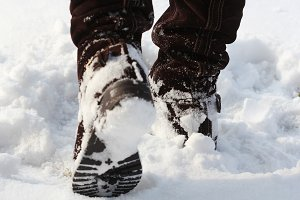 Brown women's shoes covered by snow