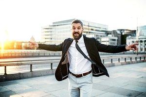Cheerful hipster businessman walking