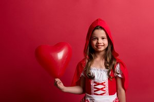 A small girl in Little Red Riding