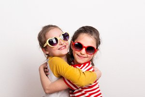 Small girls with sunglasses standing