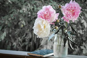 Bouquet of peonies and day planner
