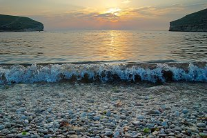 Sunset on the sea with the waves.