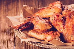 Roasted wing on wooden background