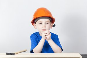 thoughtful boy in a helmet