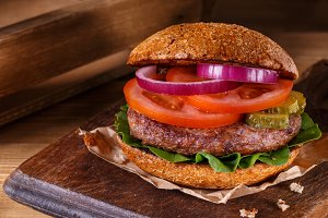 Burger on cuttind board closeup