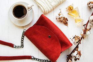 Red leather bag and cotton flowers