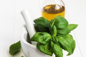 Fresh green basil and olive oil
