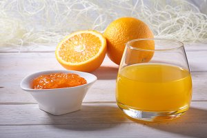 Orange jam and juice in glass