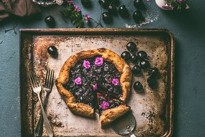 Cherry pie on aged baking tray
